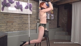 Anita De Bauch Tied With Posture Collar In Latex Shorts On The Spanish Donkey