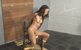 Asian Girl In Bondage Pee's Herself Then Is Hosed Down With Cold Water