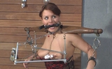 Hard Work as Her Nipples are Clamped and Pulled