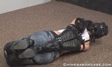 Spanked Hard then a leather Armbinder Hogtied