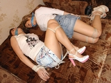Hogtied in Jean Skirts - Two Hot Babes Bound and Gagged from TwoTied.com