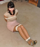 Monica is the Bitchy Boss. Ropes, high heels, skirt, cleave gagged