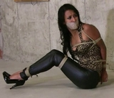 Skin tight jeans, high heels and tape gagged