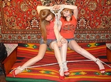 So cute in their jean mini skits and high heels, Two redheads roped together struggling against the ropes unable to cry out with cleave gags stuffed into their mouths. Bondage Video Struggle