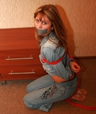 Tight Rope Escape Challenge. Red rope escape challenge, tape gagged, blue jeans, bare feet