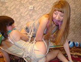 Tangled Up - Multiple women bound gagged and struggling. TwoTied.com