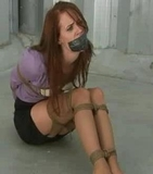 This storage unit is for his most prized possessions. Once he had this hot redhead tightly roped and tape gagged he put her into storage for future use. Of course he couldn't resist a little fondle