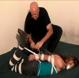Sasha Fae Bondage Interrogation - Questioned, tape gagged and hogtied on screen
