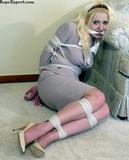 Secretary, Helpless In Her Business Suit