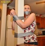 Kitchen Spanking. Taped to post, tape gag, redhead, panties, spanking