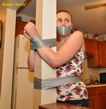 Kitchen Spanking. Taped to post, tape gag, redhead, panties, spanking
