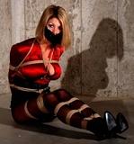 Carissa Montgomery: Satin Blouse Basement Bondage - Satin Blouse, Cleavage, Rope Breast Harness, Pantyhose, High Heels, Tape Gagged, Blonde, Black Mini Skirt