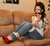 Samantha is a Car Wrecker, Corrective Punishment. Red high heels, blue jeans, rope tied, rope harness, cleave gag