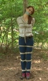 Madalynn Bound In The Woods - Tied to tree, ropes, jeans, crotch rope tape gag, redhead
