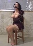 Boobs in the Basement. Ohh sexy Marie how we do love the way you thrash around violently to get free! Bondage Video Struggle from NabHer.com