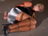 Mouth Stuffed, Gagged On Screen Basement Video Struggle. Beautiful secretary, mouth stuffed and wrap gagged, tightly roped and struggling on the basement floor by RopExpert.com