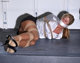 Naughty Secretary Going For a Ride! Sexy secretary ina satin blouse, mini skirt, pantyhose and high heels thrashing around RopExpert.com van in an attempt to escape! But after all of her efforts she f