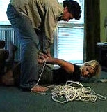 Kate Tightly Hogtied On The Floor In Her Skirt (Classic Video)