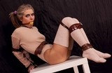 Knit top, tight leather straps and big ball gag struggle