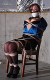 Chair Tied with Breasts Exposed