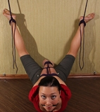 Looking up, knowing she's in trouble, desperate to get loose from the legs-spread-wide brutal bondage. Wondering how she got this way. And hoping that at some point .. soon ... he'd return ...