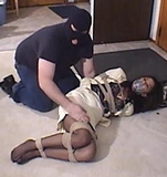 Tomiko's Surprise Visit. Stockinged feet, paid fantasy abduction, business suit, ropes, tape gag