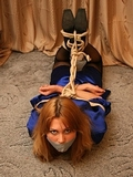 Delta Once Again Gives It Her All To Escape. Blue satin dressing gown, stockings, high heels, tape gagged, hogtied, escape challenge