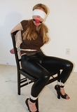 The Abduction Of Ms Jones starring Candle Boxxx. Blindfold, Chair Tied, Open Toed High Heels, Ball Gagged