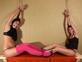 Tama and Vickie, Double String Up. Multiple women bound, high heels, gstrings, ball gagged