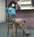 Secretary Tightly Tied To Her Chair, Bra Exposed