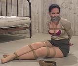 Caroline Pierce is the Basement Hostage - Tape Gagged, Mini Skirt, Stockinged Feet, Hemp Ropes