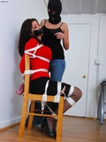 I'm Sick and Tired Of Hearing About Your Fucking Boobs & That Red Sweater! Chair Tied, Stockings, Stilettos, Black Skirt, Red Sweater, Rope Breast Harness, Tape Gagged