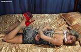 Red Stilettos Hogtie Struggle starring Roxana - Hogtied, red high heels, cleave gagged, blonde, dress