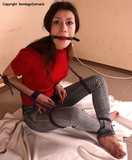 Juliana - This Could Be Fun. She likes to try something different. And our sweet young minx is trying tight, no-escape bondage. Sitting on the floor, bound, ballgagged and ...