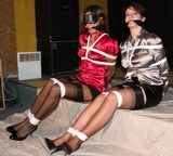 Lizabeth and Frida-Sol, Satin Blouse Bondage. Satin blouses, multiple women tied, cleave gagged, blindfold, stockings, high heels