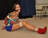 Janelynn stars in Paying The Rent. Ropes, boots, cleave gag, peril, danger