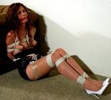 Stacie Snow Helpless and Crotch Roped - High heels, silk stockings, little black dress, boobs, cleave gagged, redhead