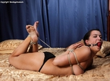 Reverse Prayer Hogtied - And Enjoying It (HD) Though not as much as she'd like to. She enjoys bondage. She craves it. Especially when she's rolling around on the bed. This time in a reverse prayer...