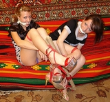 Two Hot Babes Bound And Gagged To A Rod