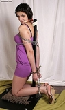 On Her Knees and Chained To A Post