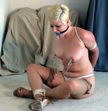 Molly Drolling Ball Gag High Heel Bondage. Ball Gagged, Ripped Stockings, Sexy Strappy High Heels, Blonde, Nipple Clamps