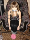 Illusio Wants To Be Just Like Houdini! Wrapped in tons of chain, knotted cleave gag. This looks like an escape artist ... if she could have gotten free that is