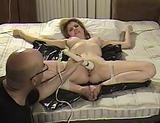 Female Ejaculation? You Bet! Watch her squirm until she arches her back and literally gets off! Naked, bound and pleasured