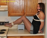 The Stalker. He tied up her up and placed her on the kitchen counter to struggle. He knew throwing the fear of falling would keep her bound and gagged for quite a while!