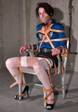 Industrial Leather Straps Hold Her Tightly To Her Chair!
