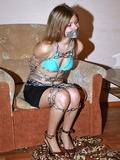 Heavy Chains and Tape Gagged in Her Bikini Top and Mini Skirt