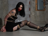 Tight Basement Bondage Struggle ... $1 SPECIAL ...Hot babe Mona struggling on the basement floor. Ohhh how I love to watch her struggle.Long legs, stockings, sexy strappy high heels, tape gag, ropes