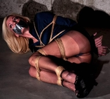 Tightly Bound Pantyhose Basement Bondage Struggle starring MoRina: High Heels, Pantyhose, Hemp Ropes, Tape Gagged, Blonde