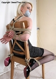 Brutal Chair Tie Struggle ... stilettos and stockings