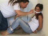 Girl next door bondage games, bare foot, blue jeans, white cotton top, no bra, knotted cleave gag, cinched rope, tied on screen